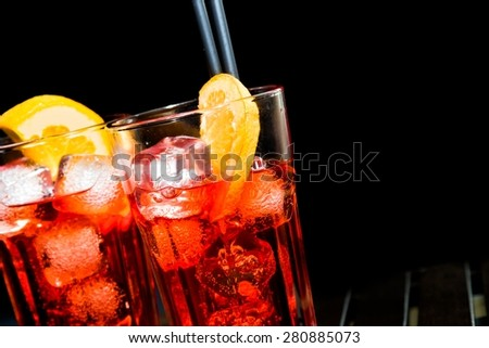 spritz aperitif aperol cocktail with orange slices and ice cubes on black background