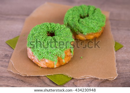 Spritz biscuits with green pearls - stock photo