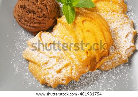 Spritz butter cookies and scoop of chocolate ice cream - stock photo