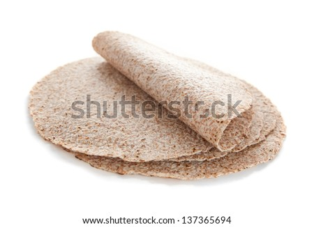 Sprouted wheat tortillas isolated on white - stock photo