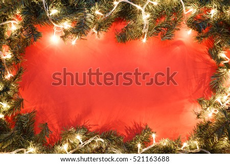 Spruce branches on red background