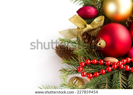 Spruce branches with cones and Christmas decorations on a white background. Space for text.
