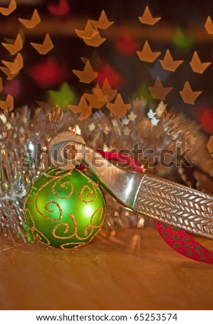 Spur and a green Christmas ball ornament - Western country style Christmas - stock photo