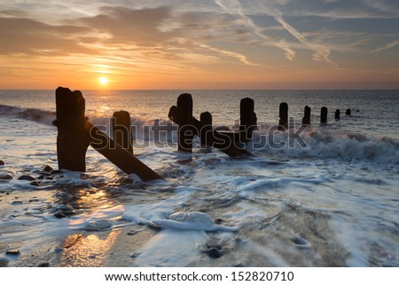 Spurn Point sea breakers (groynes) at dawn, East Yorkshire