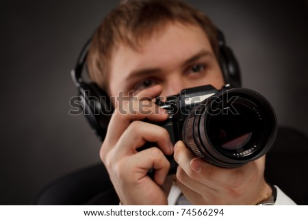 Spy with camera. - stock photo