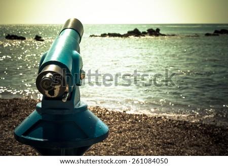 Spyglass on the Mediterranean Sea. Toned. - stock photo