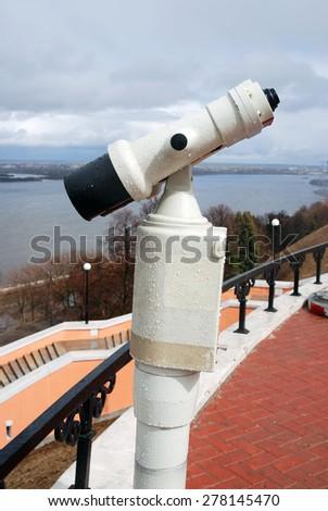 Spyglass on the observation deck. The Volga river panorama in Nizhny Novgorod, Russia. - stock photo