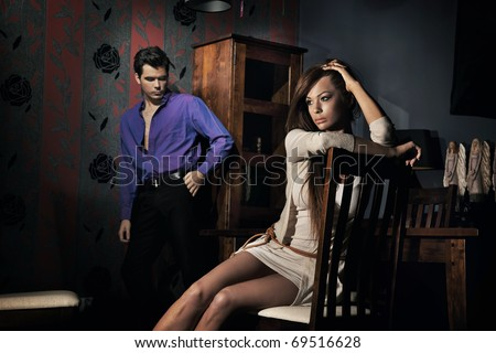 Squabbled couple in stylish apartment - stock photo
