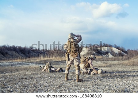 Squad of US marines waiting for medevac bird - stock photo