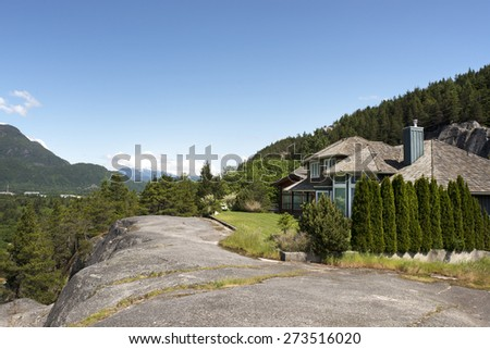 Squamish, residential house on the rock, British Ciolumbia, Canada - stock photo
