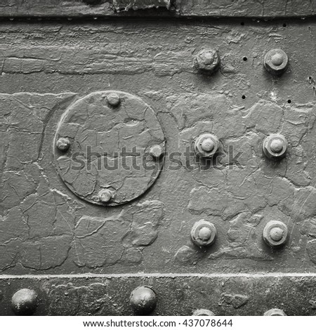 Square abstract dark gray industrial metal background texture with bolts and rivets - stock photo