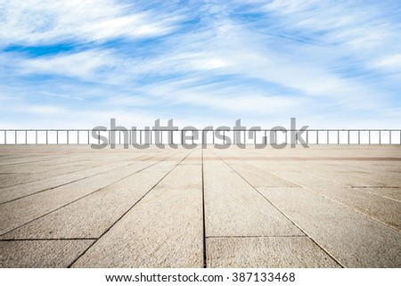 Square and blue sky - stock photo