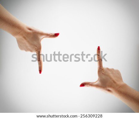 Square box is shown by hands on a clear background. - stock photo