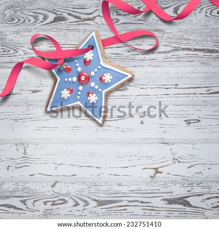Square Christmas background with gingerbread cookie decorated with royal icing against bleached wooden board. Beautiful greeting card idea. - stock photo