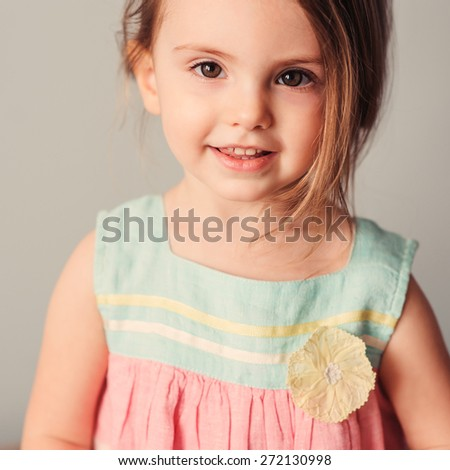 square close up portrait of happy adorable baby girl at home - stock photo