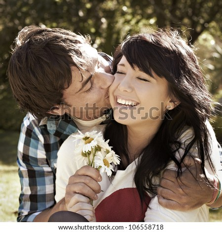 Square cropped portrait of a happy young romantic couple - stock photo