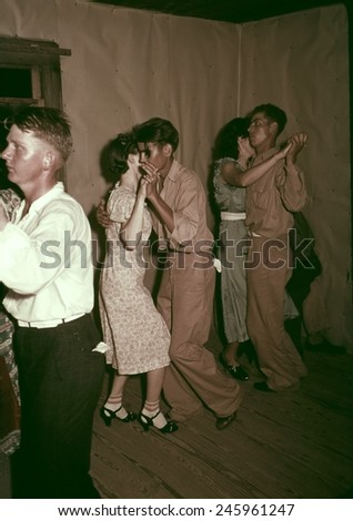 Square dance in rural home in McIntosh County Oklahoma. Ca. 1938-39.