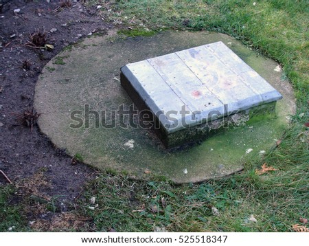 Square drains or bunker hatch tin covered outdoor close up.