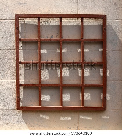 Square frame and shadows on a wall - stock photo