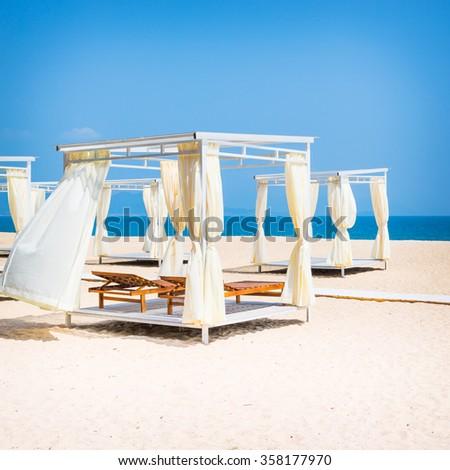 Square gazebo on a tropical beach - stock photo