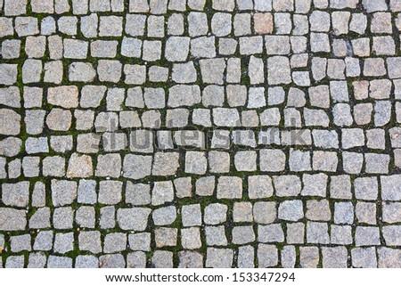 square granite stones on the pavement - stock photo
