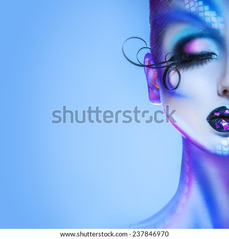 Square half face portrait of gorgeous adult woman with creative face art in studio - stock photo