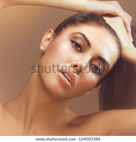 square image closeup of young beautiful female face with sensual lips looking at camera - stock photo