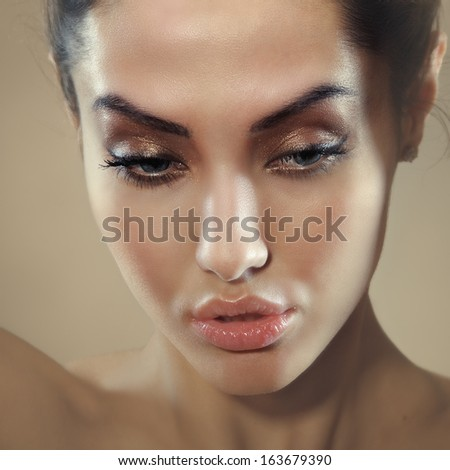 square image closeup of young beautiful female face with sensual lips looking down - stock photo