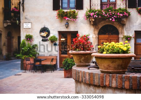 Square in front of the buildings in the medieval town in Tuscany. - stock photo