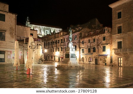 Square in Old Town Dubrovnik by rainy night, Croatia - stock photo