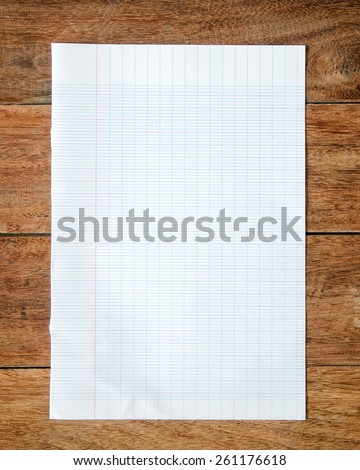 Square measure paper on wood. - stock photo