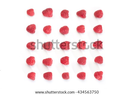 Square pattern of red raspberries, overhead from above, isolated on white background