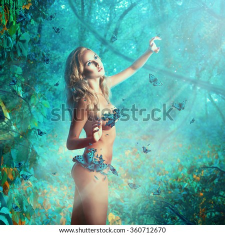 Square photo of perfect slim woman with natural breast and butterflies in the jungle - stock photo