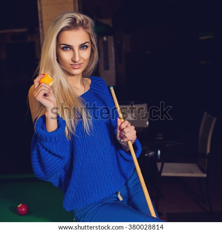 Square photo of sexual young blonde with blue eyes and cue ball in hands. Billiard sport concept. American pool billiard. Pool billiard game. - stock photo