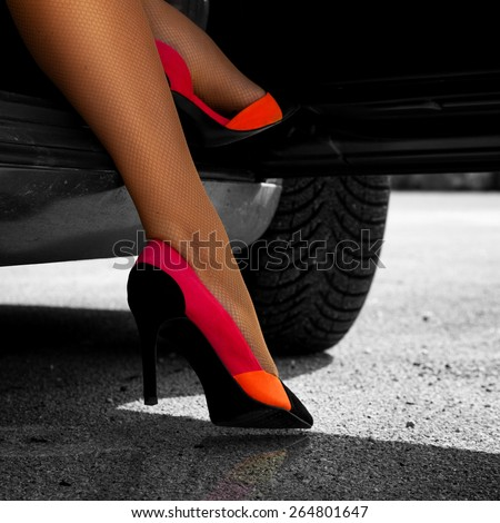 Square picture of sexual woman's feet in high heels outdoors