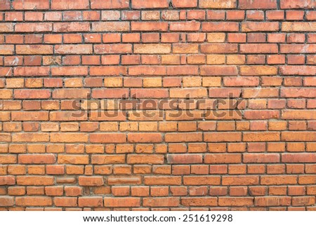 square red brick wall background. - stock photo