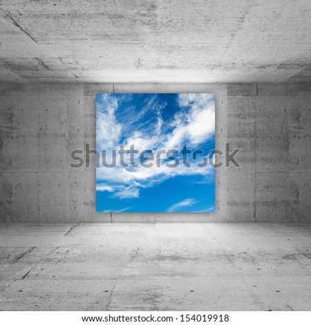 Square screen with cloudy sky glows in abstract concrete room interior - stock photo