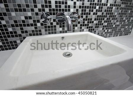 square shape white marble hand wash basin - stock photo
