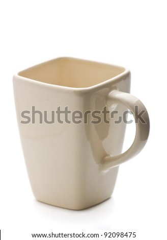 Square shaped cup on white background - stock photo