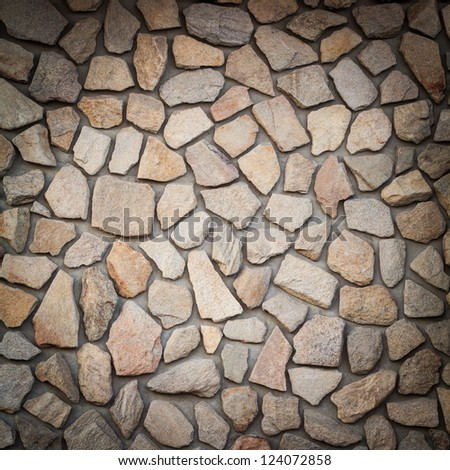 Square shot of a wall from stones - stock photo