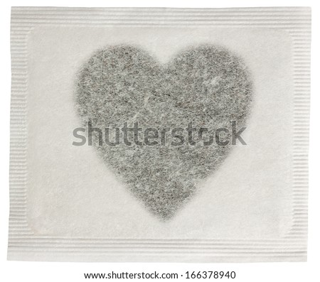 Square tea bag with tea in the shape of a heart isolated on white with clipping path - stock photo
