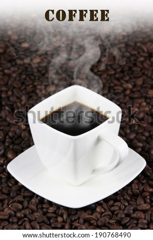 square white cup of coffee on coffee beans - stock photo