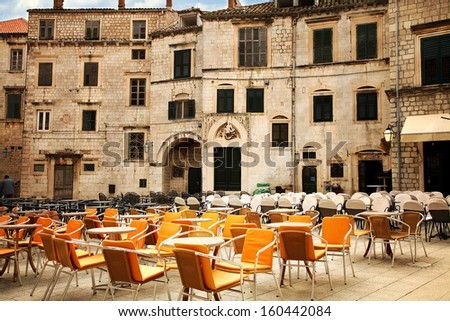 Square with cozy restaurants in Croatia, Dubrovnik after season. Famous old town fortress on the Adriatic. - stock photo
