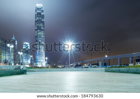 square with night modern building background - stock photo