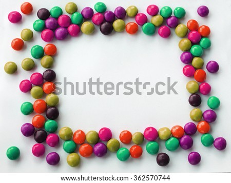 squared  frame look like sun of colorful chocolate candies on a white background with space for your text Valentines Day concept - stock photo