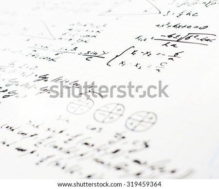 Squared sheet of paper filled with trigonometry math equations and formulas as a background composition with the shallow depth of field - stock photo