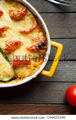 squash casserole with cheese and tomatoes, top - stock photo