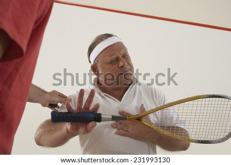 Squash Player Feeling Unwell - stock photo
