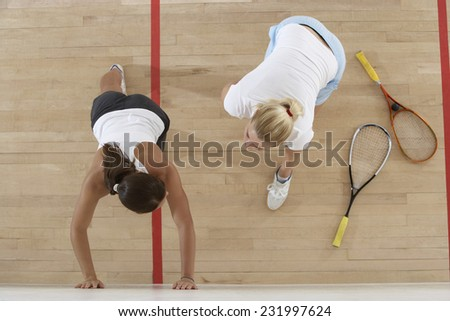 Squash Players Stretching For the Game - stock photo