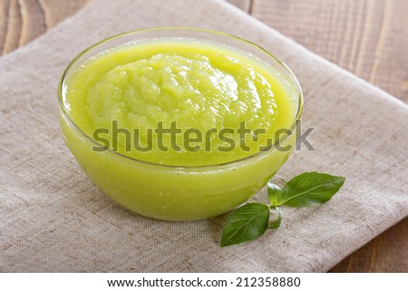 Squash puree homemade children food in a bowl - stock photo